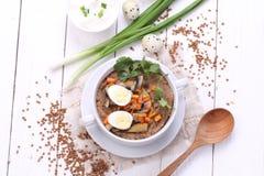 粥用蘑菇和鹌鹑蛋 库存照片