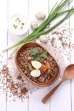 粥用蘑菇和鹌鹑蛋 免版税图库摄影
