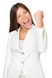 精力充沛的女实业家紧握拳头 库存照片