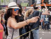 精心制作地加工好的可爱的妇女,在克里斯托弗街期间 库存图片