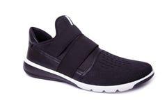 黑精神体育鞋子孤立 免版税图库摄影