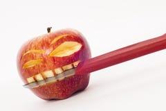 精神分析的面孔苹果 库存照片