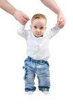 精神手抱着婴孩并且帮助他去 免版税库存图片