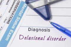 精神病学的诊断妄想症 在精神病医生工作场所是表明Delusiona诊断的医生证明 库存照片