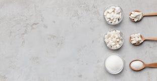 糖不同形式的汇集在灰色背景的 图库摄影