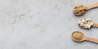 糖不同形式的汇集在灰色背景的 免版税图库摄影