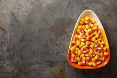 糖味玉米在碗万圣夜背景中 图库摄影