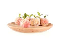 糖果在白色隔绝的木板材结果实 库存图片