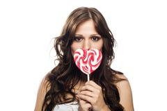 糖果棒棒糖俏丽的妇女年轻人 库存照片