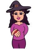 给糖果漫画人物的巫婆 库存照片