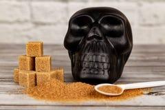 糖概念害处  糖和黑头骨形象立方体  库存照片