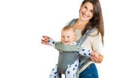 系列愉快的纵向 有婴孩的微笑的妇女 小母亲 图库摄影