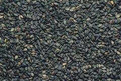 紧密黑削皮的芝麻,背景 免版税库存照片