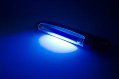 紫外的闪亮指示 库存图片