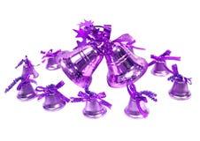 紫罗兰色圣诞节的手摇铃 免版税库存照片