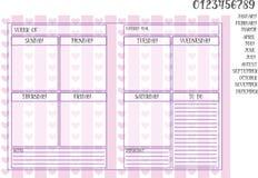 紫罗兰色镶边背景的每周计划者与心脏 免版税库存图片