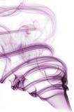 紫色卷曲的烟 库存照片