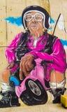 紫色的骑自行车的人 免版税图库摄影