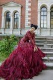 紫色礼服的美丽的巫婆 免版税库存图片