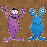 紫色蓝色逗人喜爱的妖怪 免版税库存图片