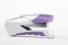 紫色银色订书机 免版税库存图片