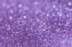 紫色闪闪发光糖 免版税库存图片