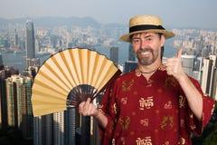 繁体中文衣服的欧洲人在香港 库存照片