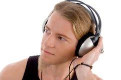 繁忙的耳机男性年轻人 免版税库存照片