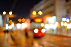 繁忙运输被弄脏的Defocused城市光在晚上 免版税库存照片