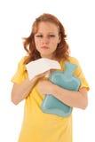 红发与热的水瓶的妇女吹的鼻子 免版税库存图片