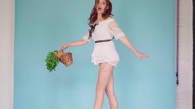 红发女孩一件白色短的礼服的和有的兔子的创造性的耳朵 影视素材