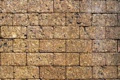 红土带石砖墙 库存图片