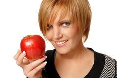 红头发人女孩用苹果 免版税库存照片