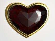 红宝石以形式在金框架的心脏 库存照片
