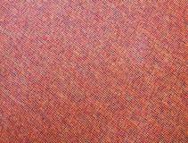 红橙色混杂的抽象织品纹理背景 图库摄影