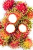 红毛丹果子和空白背景 免版税库存照片