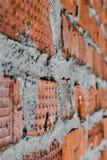 红砖墙壁由在纹理的不同的砖组成 图库摄影
