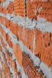 红砖墙壁由在纹理的不同的砖组成 免版税库存照片
