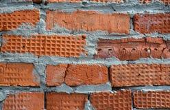 红砖墙壁由在纹理的不同的砖组成 库存照片