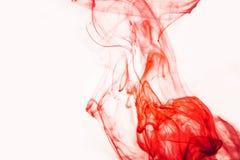 红色上色了抽象下落云彩丙烯酸酯的下面水性涂料背景黄色蓝绿色橙色波斯菊黑色抽象天空海温泉 库存照片
