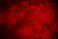 红色与被模仿的被弄脏的墨水的织品艺术性的背景 免版税库存照片