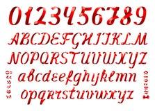红色丝带字母表信件和数字在白色背景 免版税库存照片