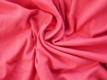 红色丝绸缎纹理,五颜六色的棉织物背景 免版税库存照片