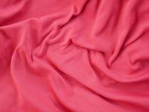 红色丝绸缎纹理,五颜六色的棉织物背景 免版税库存图片
