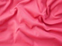 红色丝绸缎纹理,五颜六色的棉织物背景 库存照片