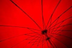 红色伞帆布 免版税库存图片