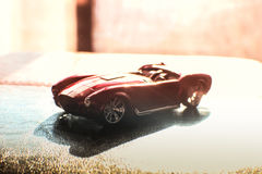 红色体育玩具车轮轮胎路 图库摄影
