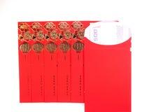 红色信封和金钱在白色背景 图库摄影