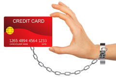 红色信用卡特写镜头由被束缚的手holded 免版税库存图片