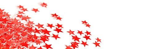 红色假日发光的小的星制表在白色背景的装饰品 库存照片